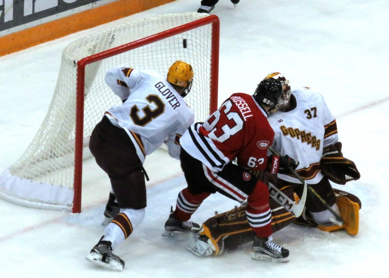 Patrick Russell tips a shot past U of MN goaltender Nick Lehr in the third period Sunday
