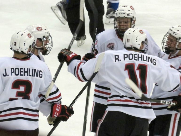 Ryan Poehling celebrates his first goal as a Husky on Friday (photo prout)