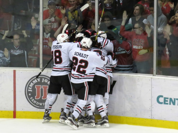 The Huskies celebrate Mikey Eyssimont's game-winning gal on Saturday (photo prout)