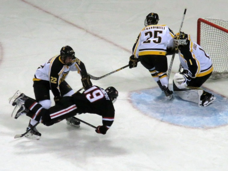 Mikey Eyssimont goes airborne in the third period on Saturday (photo prout)