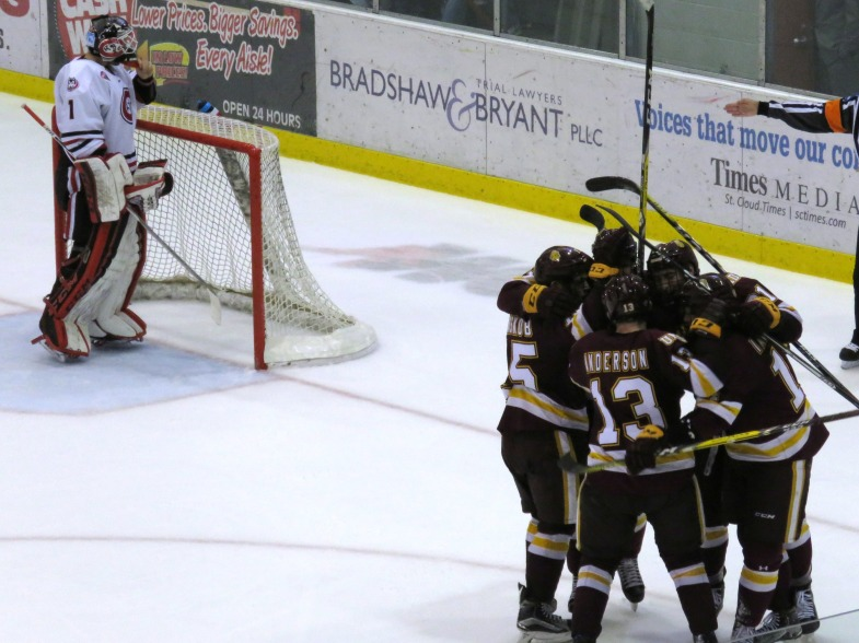 The Bulldogs celebrate Joey Anderson's third period goal Friday (photo prout)