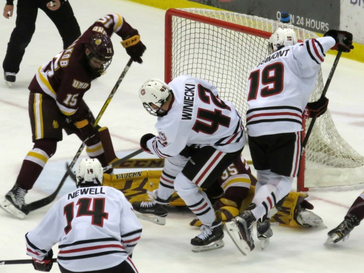 Blake Winiecki and Mikey Eyssimont battle in front of the UMD goal on Saturday (photo prout)