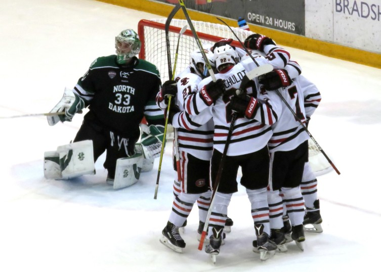The Huskies celebrate a goal vs North Dakota last November in St. Cloud (photo prout)