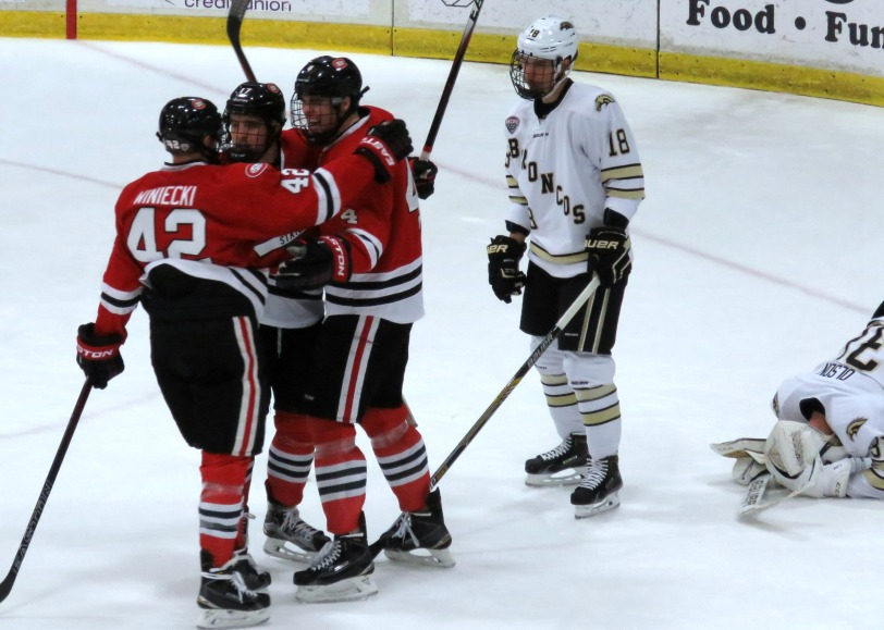 The Huskies celebrate a win over the Broncos in Kalamazooo last November (photo prout)