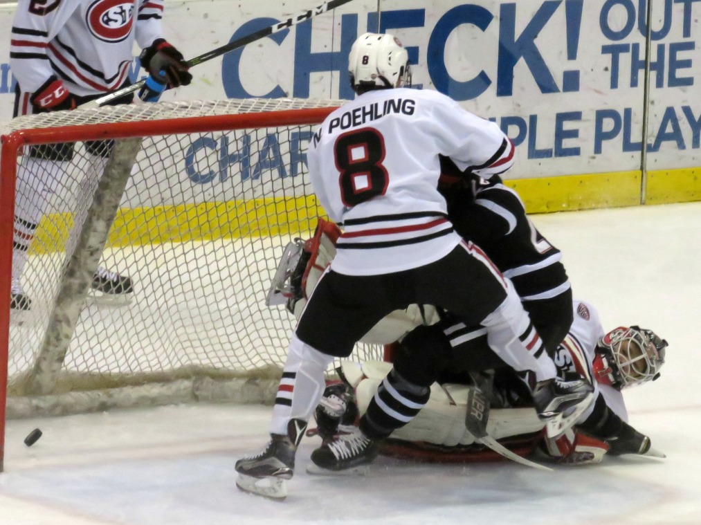 The puck gets past SCSU netminder Jeff Smith in the thtd period Saturday (photo prout)