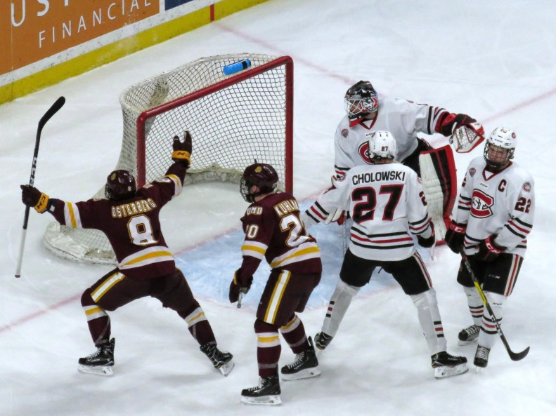 Kyle Osterberg celebrates his overtime game-winner in the North Star College Cup (photo prout)