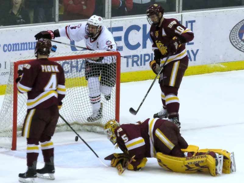 Ben Storm celebrates a goal vs UMD in St. Cloud in November (Photo Prout)