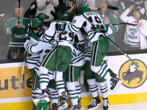 UND celebrates Mike Gornall's overtime goal on Saturday (photo prout)